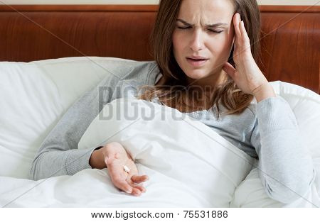 Female Taking Painkillers