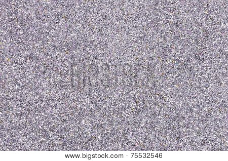 Closeup of a silver background with glitter