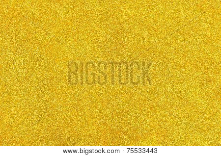 Closeup of a golden background with glitter