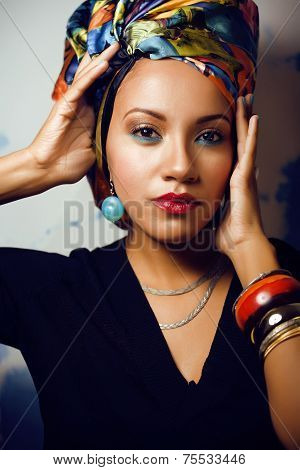 beautiful bright African woman with creative make up