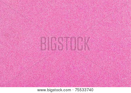 Closeup of a pink background with glitter