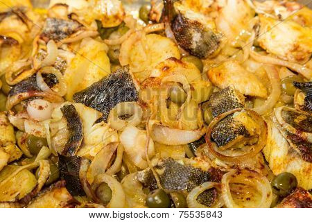 Close up of a delicious and traditional portuguese codfish and potatoes