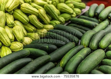 Background with chayote and cucumbers