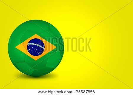 Soccer ball with Brazilian flag isolated on yellow