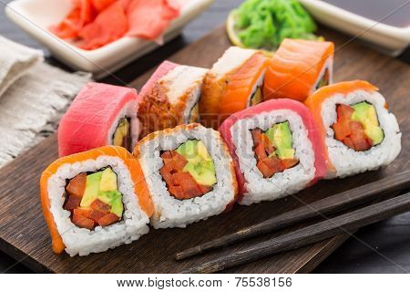 Rainbow sushi roll with salmon, tuna and eel