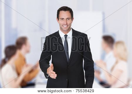 Portrait Of Happy Middle Aged Businessman