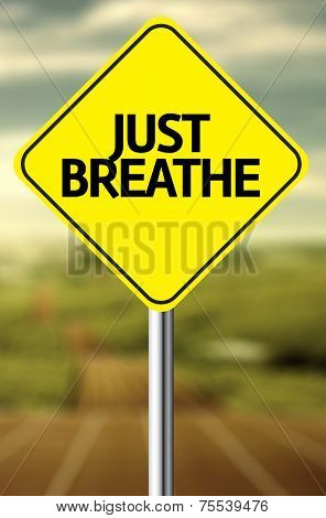 Creative sign with the message - Just Breathe
