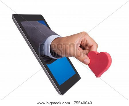 Hand Holding Heart Shape Coming From Tablet