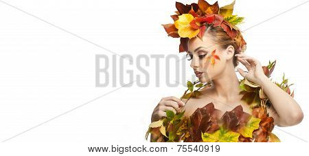 Autumnal woman. Beautiful creative makeup and hair style in fall concept studio shot. Beauty fashion