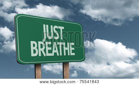 Amazing sign on the road with the message - Just Breathe