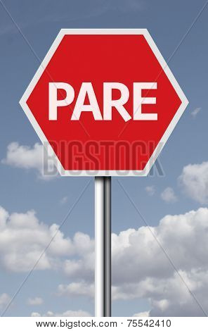 Stop (Pare in Portuguese) sign on sky background