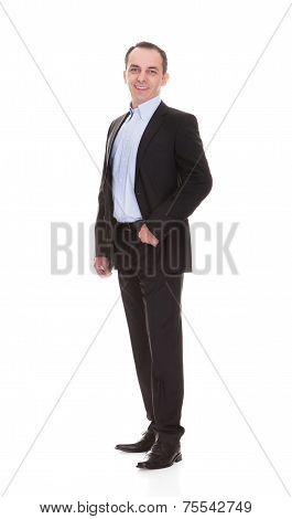 Full Length Portrait Of Happy Mature Businessman