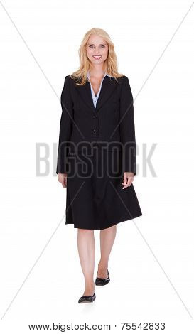 Confident Businesswoman Walking Over White Background
