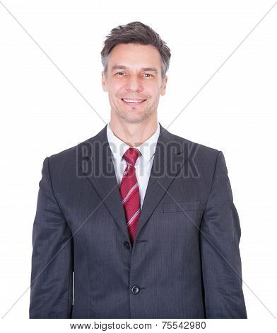 Smiling Businessman Against White Background