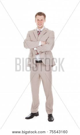 Portrait Of Handsome Businessman Standing Arms Crossed