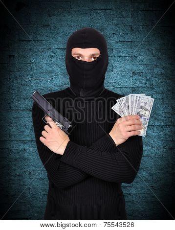 Terrorist Holding Gun And Dollars