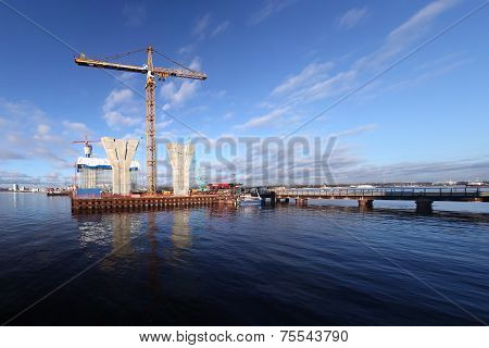 Construction Site On Platform Surrounded By Water, Building Cable-stayed Bridge.