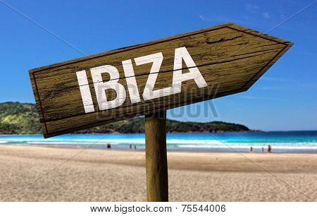 Ibiza wooden sign with a beach on background