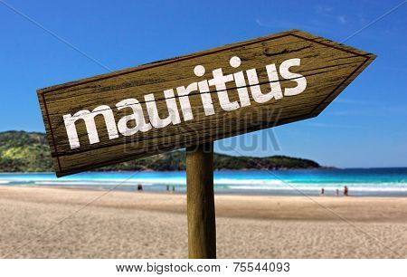 Mauritius wooden sign with a beach on background