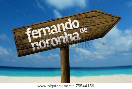 Fernando de Noronha, Brazil wooden sign with a beach on background