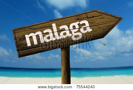 Malaga wooden sign with a beach on background