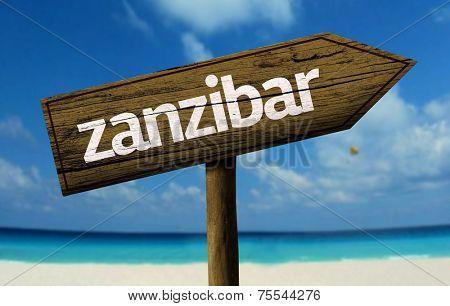 Zanzibar wooden sign with a beach on background