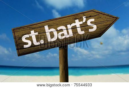 St. Bart's wooden sign with a beach on background