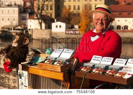 PRAGUE, CZECH REPUBLIC, - SEPTEMBER 7:  Man offers music from hand operated music box in exchange for money on Charles Bridge on September 7, 2012 in Prague, Czech Republic
