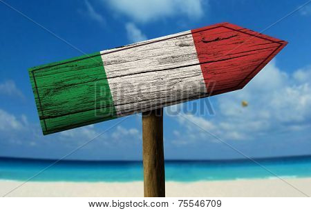 Italy flag wooden sign with a beach on background - Europe