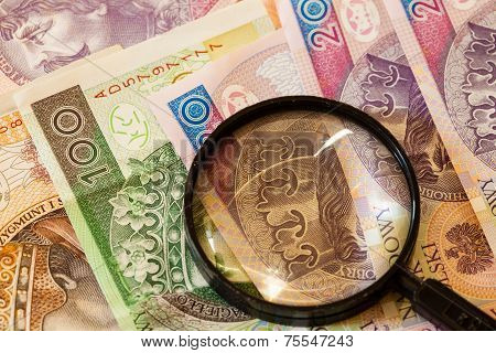Polish Zloty Currency And Magnifying Glass