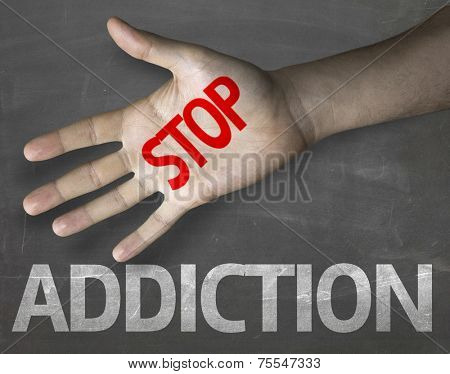 Educational and Creative composition with the message Stop Addiction on the blackboard