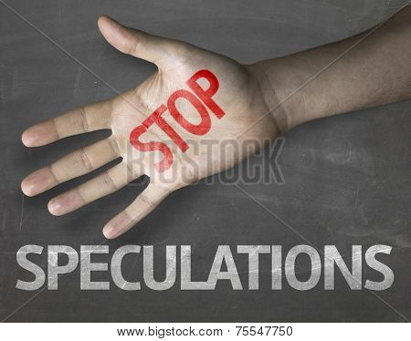 Educational and Creative composition with the message Stop Speculations on the blackboard
