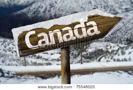 Canada wooden sign with a snow background