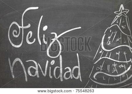 Christmas tree on blackboard and the text Feliz Navidad ( Merry Christmas in Spanish )