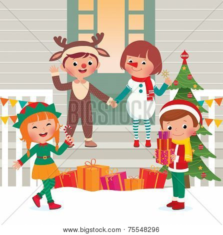 Children On The Doorstep In Christmas Costumes