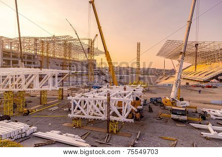 SAO PAULO, BRAZIL - JUNE 27: Engineers construct the Arena Corinthians in Itaquera on June 27, 2013. The Arena is future home ground of Corinthians and will be the Arena for the 2014 World Cup.