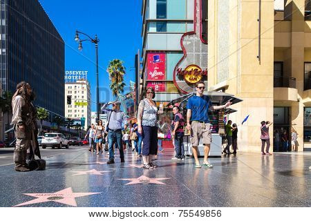 LOS ANGELES, USA - SEPTEMBER 27: Tourists walk on Hollywood Walk of Fame on September 27, 2013 in Hollywood, Los Angeles - California. There are over 2400 celebrity stars on Hollywood Blvd.