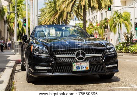 BEVERLY HILLS, CA - SEP 20: Mercedes Benz in Rodeo Drive in Beverly Hills on September 20, 2013. Rodeo Drive is an affluent shopping district known for designer label and haute couture fashion.