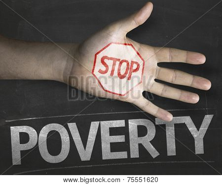 Educational and Creative composition with the message Stop Poverty on the blackboard