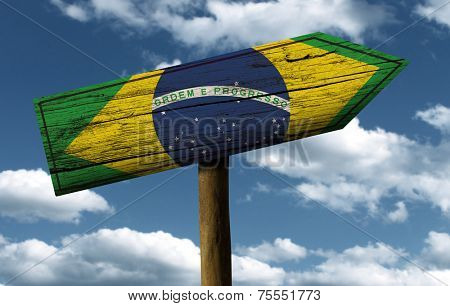 Brazil flag wooden sign with a beautiful sky on background - Latin America