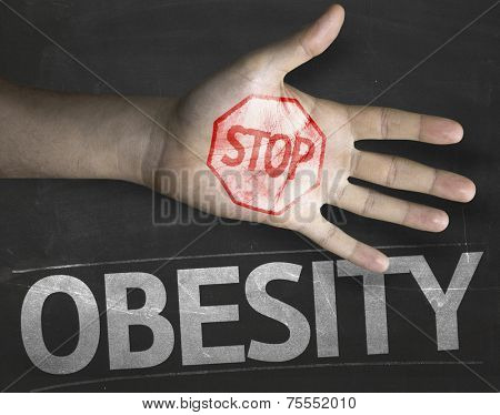 Educational and Creative composition with the message Stop Obesity on the blackboard