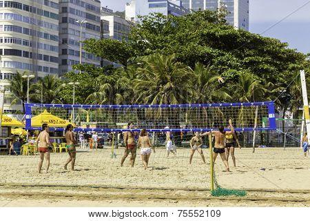 RIO DE JANEIRO, BRAZIL - NOV 03: People play volleyball in Copacabana beach on November 03, 2013 in Rio de Janeiro, Brazil. Copacabana beach is one of the most famous beaches in Rio de Janeiro.