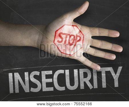Educational and Creative composition with the message Stop Insecurity on the blackboard