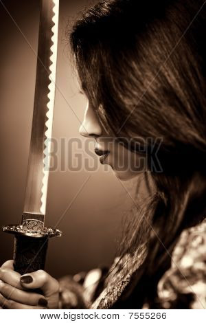 Young Woman With Samurai Sword