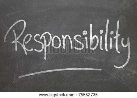 Responsibility word in white chalk handwriting on the blackboard