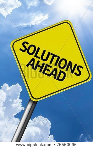 Solutions Ahead creative sign on a beautiful blue sky