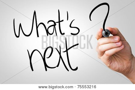 Whats next hand writing with a black mark on a transparent board