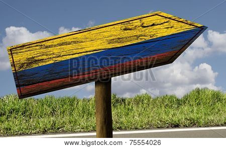 Colombia flag wooden sign on the road - Latin America
