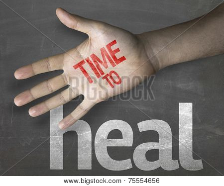Educational and Creative composition with the message Time to Heal on the blackboard
