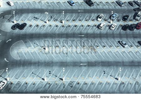 Car park seen from above with many empty parking lots